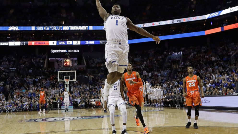 Duke's Zion Williamson (1) goes up to dunk against Syracuse during the first half of an NCAA college basketball game in the Atlantic Coast Conference tournament in Charlotte, N.C., Thursday, March 14, 2019. (AP Photo/Chuck Burton)