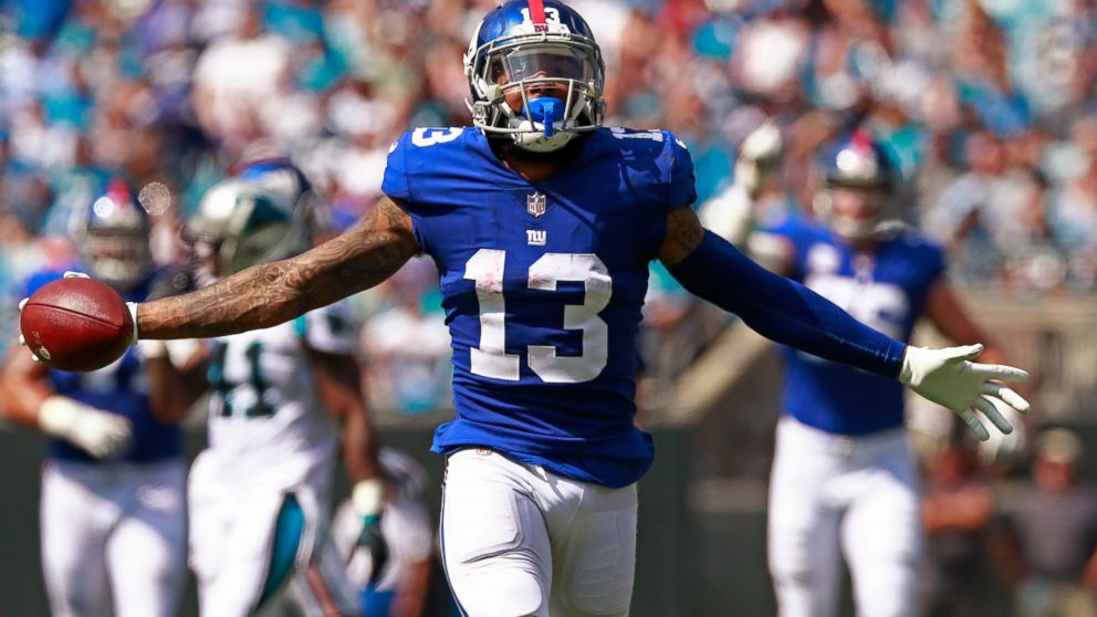 FILE - In this Oct. 7, 2018, file photo, New York Giants' Odell Beckham Jr. celebrates a catch against the Carolina Panthers during the first half of an NFL football game in Charlotte, N.C. Two people familiar with the blockbuster trade say the Cleveland Browns have agreed to acquire Beckham from the Giants. (AP Photo/Jason E. Miczek, File)