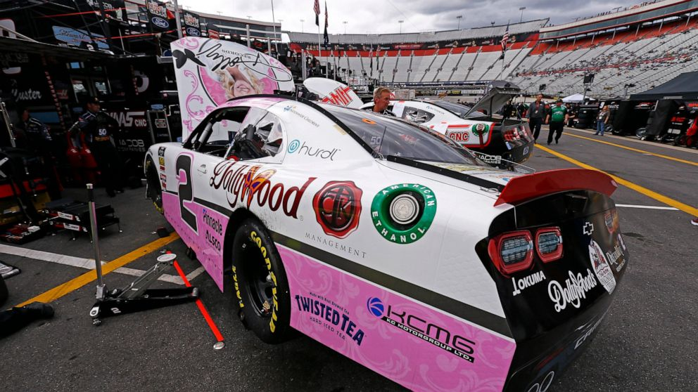 The car of driver Tyler Reddick sits in the pits being worked on after practice for the NASCAR Xfinity Series auto race Friday, April 5, 2019, in Bristol, Tenn. The reigning Xfinity Series champion is piloting a Chevrolet at Bristol covered with country music icon Dolly Parton's face and her signature butterfly logo.(AP Photo/Wade Payne)