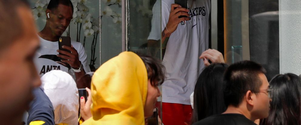 NBA players use their smartphones to film fans gathers outside the Ritz-Carlton hotel in Shanghai, China, Thursday, Oct. 10, 2019. NBA Commissioner Adam Silver told the Brooklyn Nets and Los Angeles Lakers on Wednesday that the league is still expect