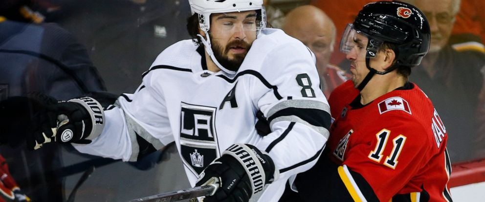 Los Angeles Kings Drew Doughty, left, is checked by Calgary Flames Mikael Backlund during the first period of an NHL hockey game Tuesday, Oct. 8, 2019, in Calgary, Alberta. (Jeff McIntosh/The Canadian Press via AP)