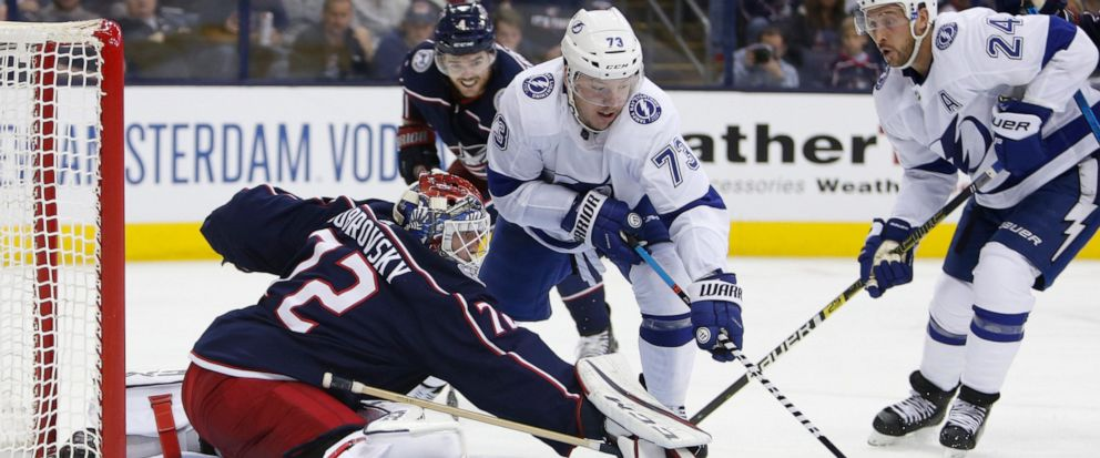 Columbus Blue Jackets Sergei Bobrovsky, left, of Russia, makes a save against Tampa Bay Lightnings Adam Erne during the third period of Game 3 of an NHL hockey first-round playoff series Sunday, April 14, 2019, in Columbus, Ohio. The Blue Jackets b