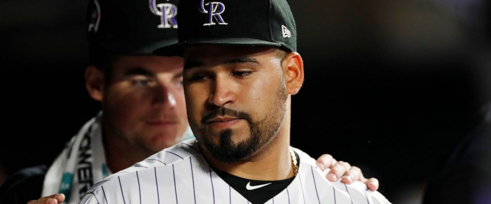 Colorado Rockies starting pitcher Antonio Senzatela, front, is congratulated by pitcher Peter Lambert after Senzatella was replaced for a pinch-hitter during the sixth inning of a baseball game against the St. Louis Cardinals on Wednesday, Sept. 11,