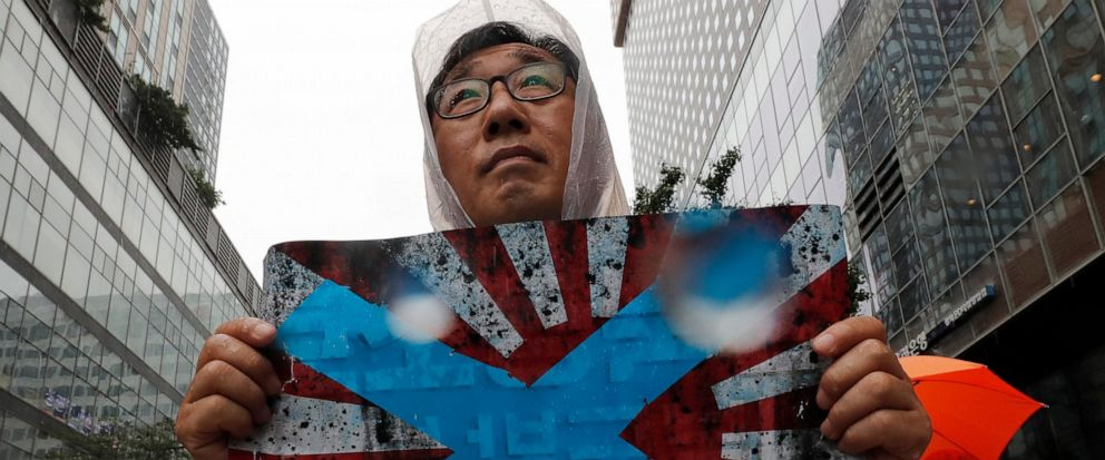 FIEL - In this Aug. 15, 2019, file photo, South Korean protesters hold Japanese rising sun flags during a rally to mark the South Korean Liberation Day from Japanese colonial rule, in downtown Seoul, South Korea. South Korea has formally asked the In