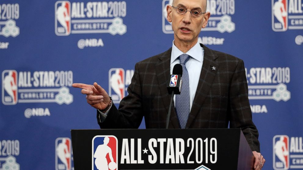 """FILE - In this Feb. 16, 2019, file photo, NBA Commissioner Adam Silver speaks during NBA All-Star festivities in Charlotte, N.C. A person with knowledge of the matter says that the NBA recently sent a proposal to the National Basketball Players Association about lowering the minimum age to enter the NBA Draft from 19 to 18, as the sides continuing moving toward eliminating the """"one-and-done"""" policy that has many elite players going to college for one season. (AP Photo/Gerry Broome, File)"""