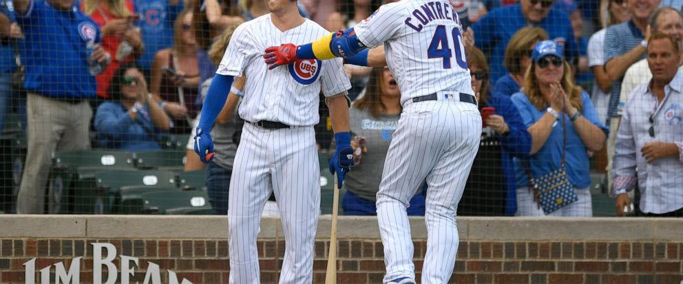Chicago Cubs Willson Contreras (40) celebrates with teammate Nico Hoerner left, after hitting a solo home run during the first inning of a baseball game against the Pittsburgh Pirates, Friday, Sept. 13, 2019, in Chicago. (AP Photo/Paul Beaty)