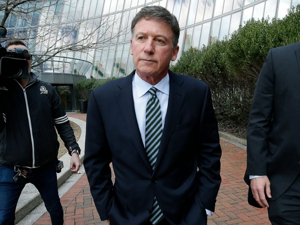Bruce Isackson departs federal court in Boston on Wednesday, April 3, 2019, after facing charges in a nationwide college admissions bribery scandal.