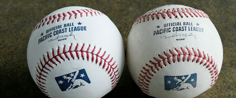 In this May 7, 2019 photo, the new official Triple-A league baseball, left, is seen beside a baseball from the previous year. The new ball is the same as the big-league ball, it is said to be harder, more tightly wound at its core and with slightly l