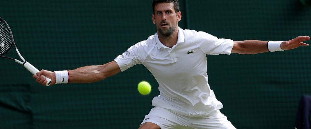 Serbias Novak Djokovic returns the ball to Spains Roberto Bautista Agut during a mens singles semifinal match on day eleven of the Wimbledon Tennis Championships in London, Friday, July 12, 2019. (AP Photo/Ben Curtis)
