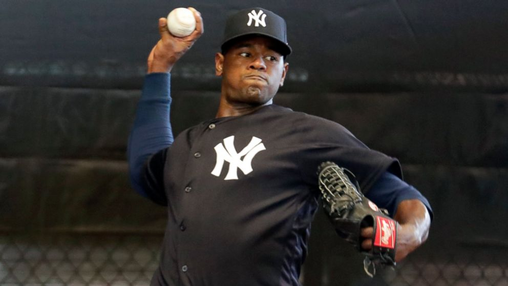FILE - In this Feb. 14, 2019, file photo, New York Yankees starting pitcher Luis Severino throws in the bullpen at the Yankees spring training baseball facility, in Tampa, Fla. Severino has been scratched from his first scheduled spring training start due to right shoulder discomfort. Severino was slated to face the Atlanta Braves on Tuesday, March 5, 2019, but was replaced by Stephan Tarpley.(AP Photo/Lynne Sladky, File)