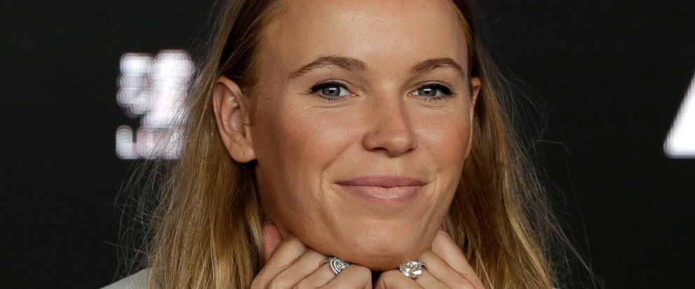 Defending womens singles champion Denmarks Caroline Wozniacki answers questions during a press conference at the Australian Open tennis championships in Melbourne, Australia, Sunday, Jan. 13, 2019. (AP Photo/Kin Cheung)