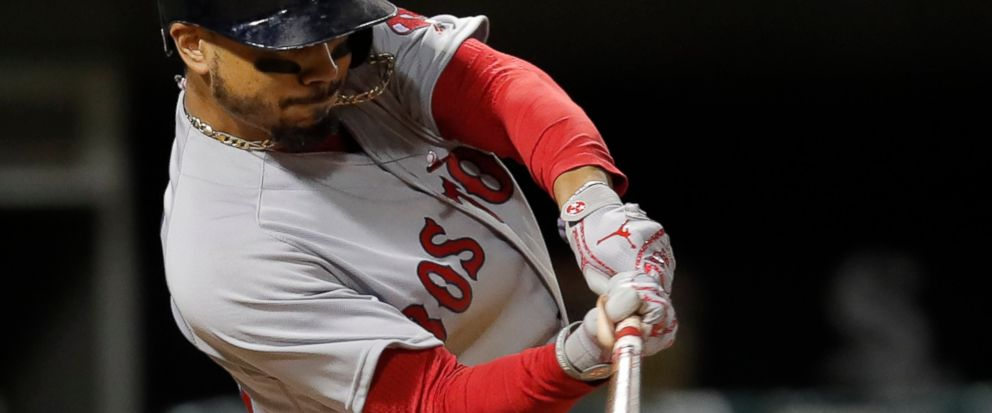 FILE - In this Thursday, Aug. 30, 2018, file photo, Boston Red Soxs Mookie Betts hits a two-run home run against the Chicago White Sox during the seventh inning of a baseball game in Chicago. Betts and the World Series champion Red Sox agreed to a $