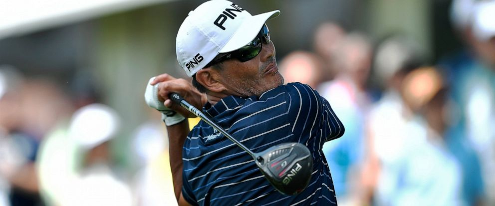 1ef5d6f6 Ken Tanigawa watches his tee shot on the first hole during the final round  of the