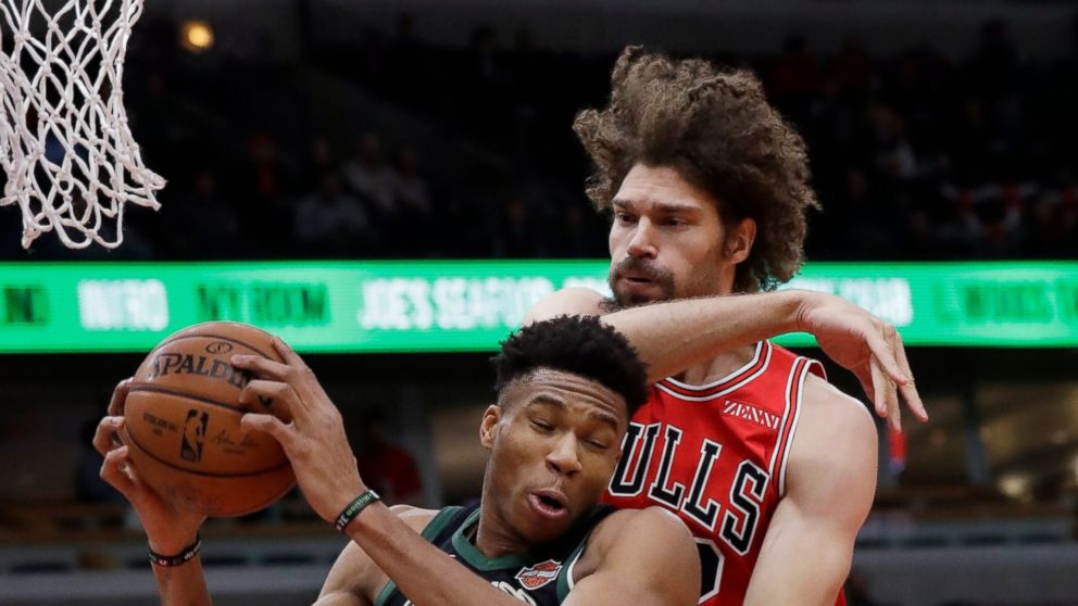 Milwaukee Bucks Forward Giannis Antetokounmpo Left Rebounds A Ball Against Chicago Bulls Center Robin