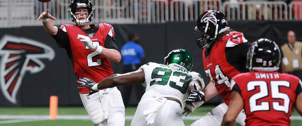 Atlanta Falcons quarterback Matt Ryan dumps off a pass to running back Ito Smith under pressure from New York Jets linebacker Tarell Basham during the first quarter of an NFL football preseason game Thursday, Aug. 15, 2019, in Atlanta. (Curtis Compto