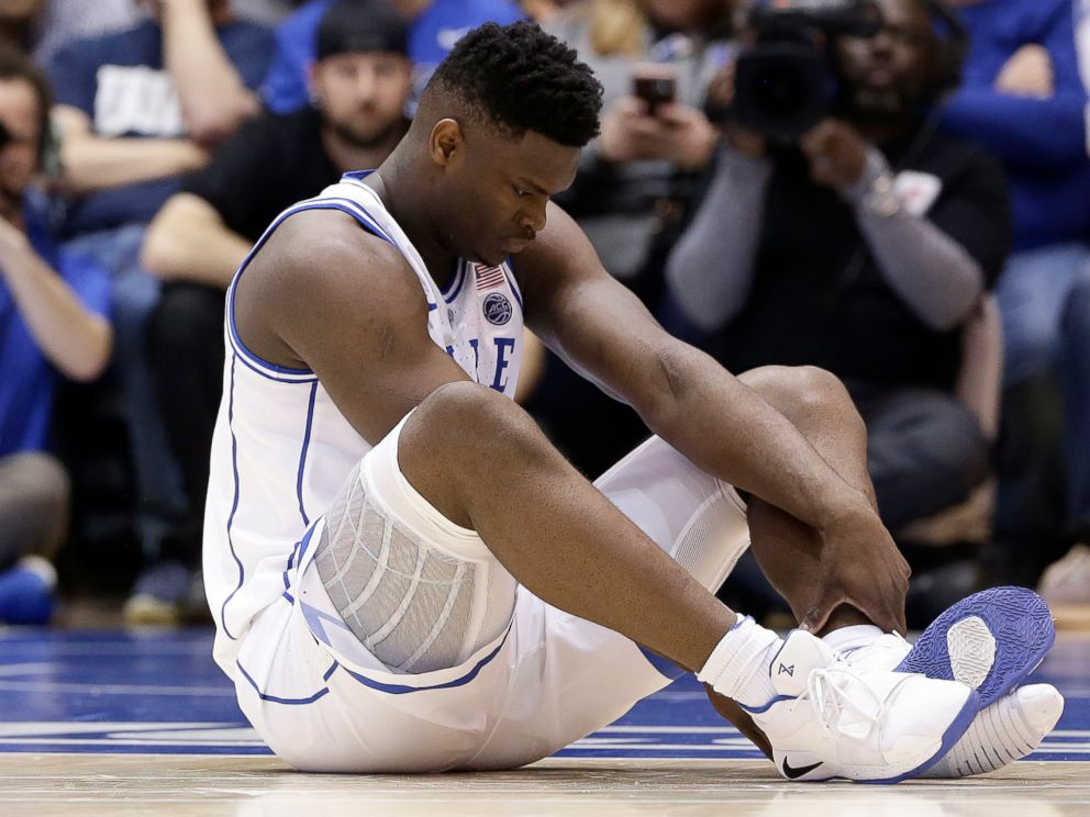 Dukes Zion Williamson sits on the floor following a injury during the first half of an NCAA college basketball game against North Carolina in Durham, N.C., Wednesday, Feb. 20, 2019.
