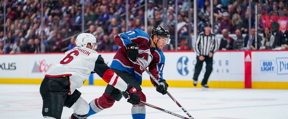 Arizona Coyotes defenseman Jakob Chychrun (6) breaks his stick while trying to defend against a Colorado Avalanche center Tyson Jost (17) shot on goal during the first period of an NHL hockey game, Saturday, Oct. 12, 2019, in Denver. (AP Photo/Jack D