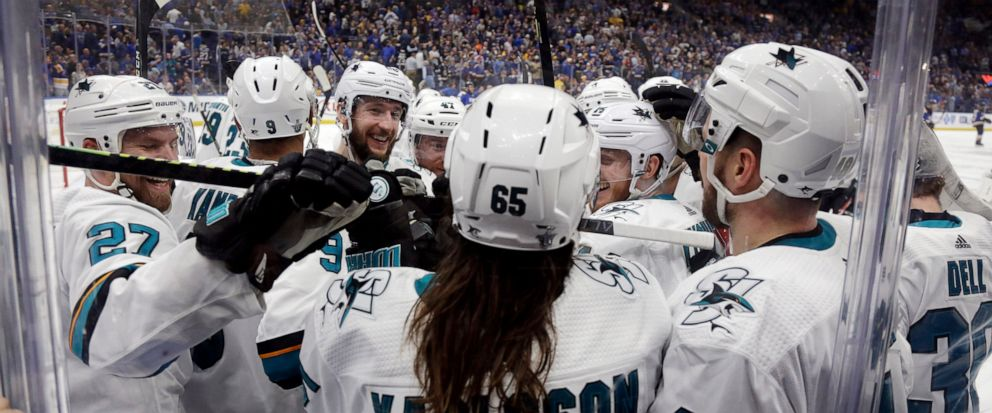 San Jose Sharks defenseman Erik Karlsson (65), of Sweden, is congratulated after scoring the winning goal against the St. Louis Blues during overtime in Game 3 of the NHL hockey Stanley Cup Western Conference final series Wednesday, May 15, 2019, in