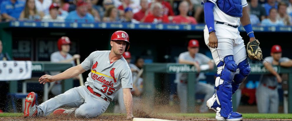 St. Louis Cardinals Lane Thomas slide home to score on a single by Tommy Edman during the third inning of a baseball game against the Kansas City Royals Tuesday, Aug. 13, 2019, in Kansas City, Mo. (AP Photo/Charlie Riedel)