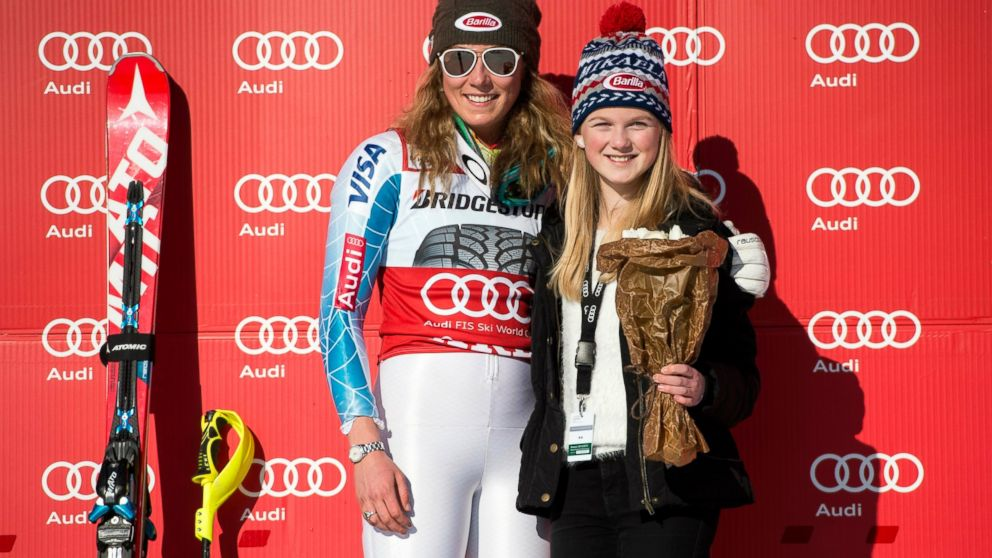 FILE - In this Saturday March 14, 2015 file photo, winner Mikaela Shiffrin of the US, left, celebrates with her fan Emma Lundell on the podium after the women's FIS Alpine Ski World Cup slalom in Are, Sweden. Mikaela Shiffrin is adding a new twist to the usual relationship between star athlete and worshipping fans. The overall World Cup leader and two-time Olympic champion has started a social media campaign labeled (hashstag) IAmYourBiggestFan to shine light on some of her supporters who she draws inspiration from. Consider cancer survivor Emma Lundell, a young cross country skier from Sweden who Shiffrin met back in 2012 on the day of her first career World Cup victory in Are. (AP Photo/Pontus Lundahl, TT, File ) SWEDEN OUT