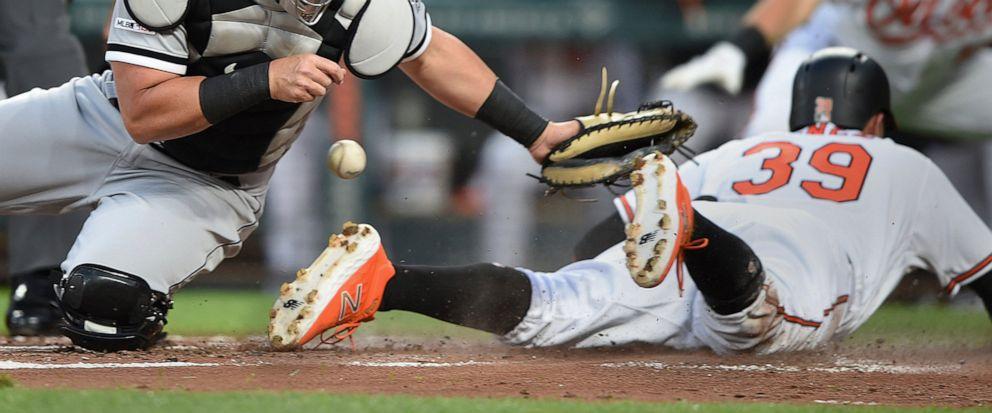 2fee4c625 Chicago White Sox catcher James McCann loses the ball as Baltimore Orioles  Renato Nunez slides safely