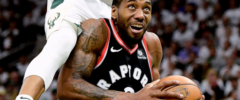 Toronto Raptors forward Kawhi Leonard (2) is fouled by Milwaukee Bucks forward Giannis Antetokounmpo (34) during the second half in Game 1 of the NBA basketball playoffs Eastern Conference final in Milwaukee on Wednesday, May 15, 2019. (Frank Gunn/Th