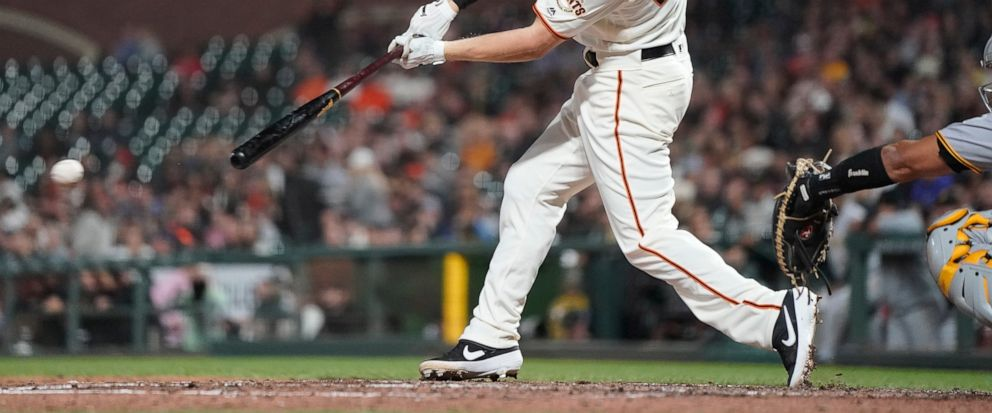 San Francisco Giants Corban Joseph hits a grounder that scored a run against the Pittsburgh Pirates during the fifth inning of a baseball game Wednesday, Sept. 11, 2019, in San Francisco. (AP Photo/Tony Avelar)