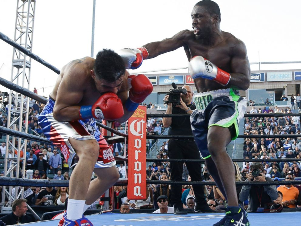 Andre Berto, right, lands a punch to Victor Ortiz during the fourth round of a welterweight boxing match, Saturday, April 30, 2016, in Carson, Calif. Berto won by knockout in the fourth round.