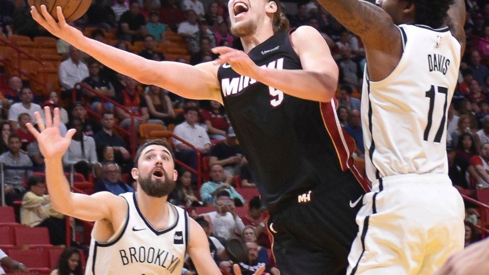 Miami Heat forward Kelly Olynyk (9) is fouled by Brooklyn Nets forward Ed  Davis 6685ee32b