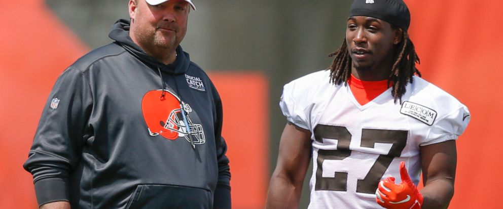 Cleveland Browns Kareem Hunt (27) talks with head coach Freddie Kitchens during an NFL football organized team activity session at the teams training facility Wednesday, May 15, 2019, in Berea, Ohio. (AP Photo/Ron Schwane)