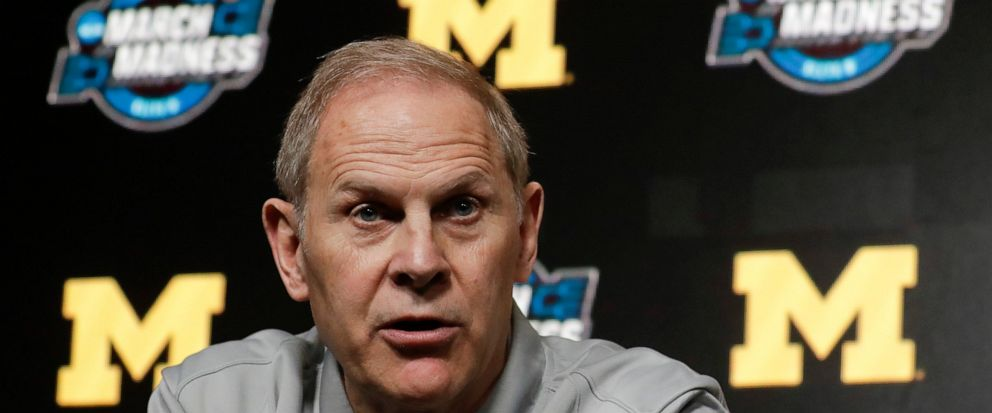 FILE - In this March 27, 2019 file photo Michigan head coach John Beilein speaks during a news conference at the NCAA college basketball tournament in Anaheim, Calif. Two people familiar with the decision say Beilein has agreed to become head coach o
