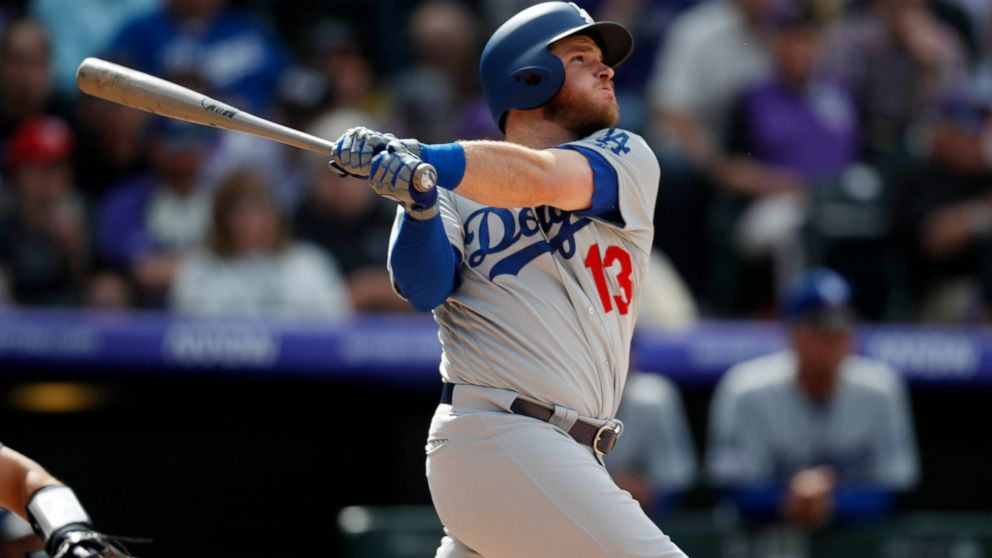 Los Angeles Dodgers' Max Muncy follows the flight of his solo home run off Colorado Rockies starting pitcher Tyler Anderson in the fourth inning of a baseball game Friday, April 5, 2019, in Denver. (AP Photo/David Zalubowski)
