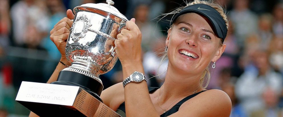 FILE - In this Saturday June 9, 2012 file photo, Maria Sharapova of Russia holds the trophy after winning the womens final match against Sara Errani of Italy at the French Open tennis tournament in Roland Garros stadium in Paris. Two-time French Ope
