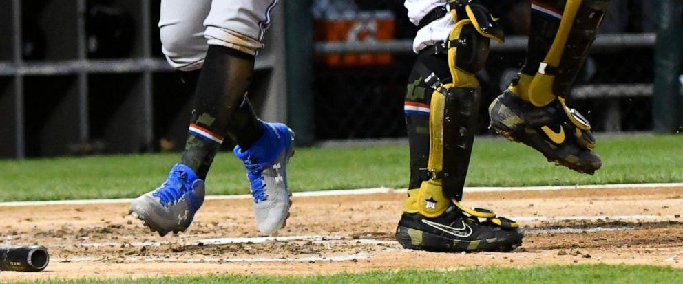 Toronto Blue Jays Vladimir Guerrero Jr., left, scores past Chicago White Sox catcher James McCann during the third inning of a baseball game Friday, May 17, 2019, in Chicago. (AP Photo/Matt Marton)