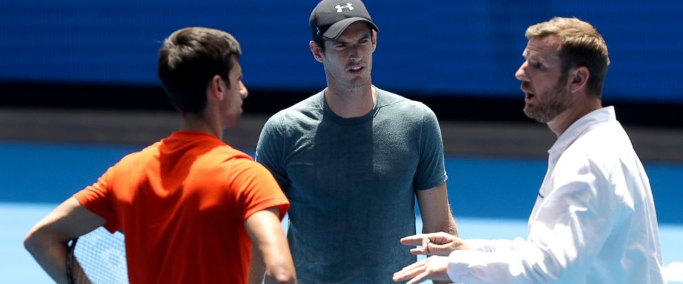 Match umpire Simon Canavan, right, talks with Britains Andy Murray, centre, and Serbias Naval Djokovic ahead of their practice match at the Australian Open tennis championships in Melbourne, Australia, Thursday, Jan. 10, 2019. (AP Photo/Mark Baker)