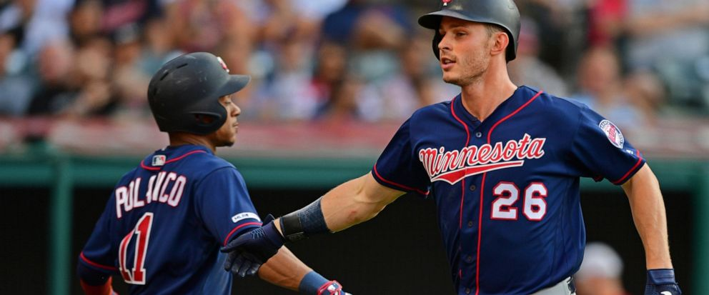 Minnesota Twins Max Kepler, right, is congratulated by Jorge Polanco after hitting a solo home run off Cleveland Indians starting pitcher Trevor Bauer in the second inning of a baseball game, Saturday, July 13, 2019, in Cleveland. (AP Photo/David Dermer)