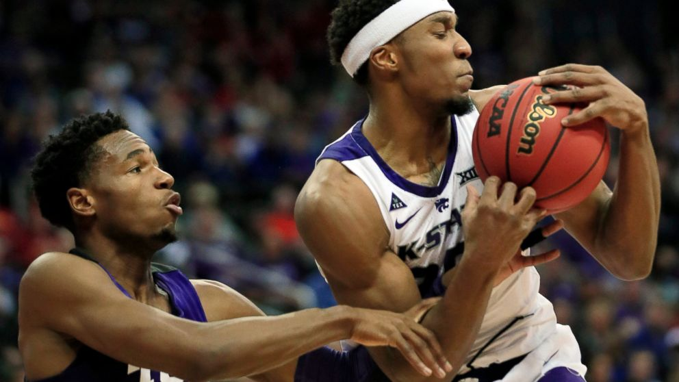 Kansas State forward Xavier Sneed, right, rebounds against TCU guard RJ Nembhard (22) during the first half of an NCAA college basketball game in the quarterfinals of the Big 12 conference tournament in Kansas City, Mo., Thursday, March 14, 2019. (AP Photo/Orlin Wagner)