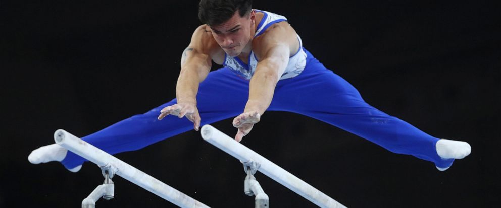 Artur Dalaloyan of Russia performs on the parellel bars in the mens team final at the Gymnastics World Championships in Stuttgart, Germany, Wednesday, Oct. 9, 2019. (AP Photo/Matthias Schrader)