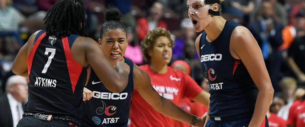 Washington Mystics Elena Delle Donne, right, celebrates a play with Ariel Atkins, left, and Natasha Cloud, center, during the second half in Game 4 of basketballs WNBA Finals against the Connecticut Sun, Tuesday, Oct. 8, 2019, in Uncasville, Conn.