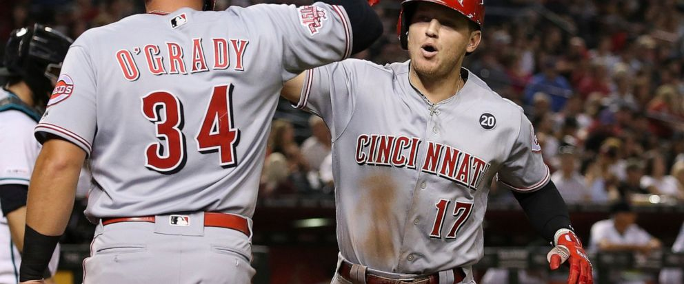 Cincinnati Reds Josh VanMeter (17) celebrates his two-run home run against the Arizona Diamondbacks with teammate Brian OGrady (34) during the fifth inning of a baseball game Friday, Sept. 13, 2019, in Phoenix. (AP Photo/Ross D. Franklin)