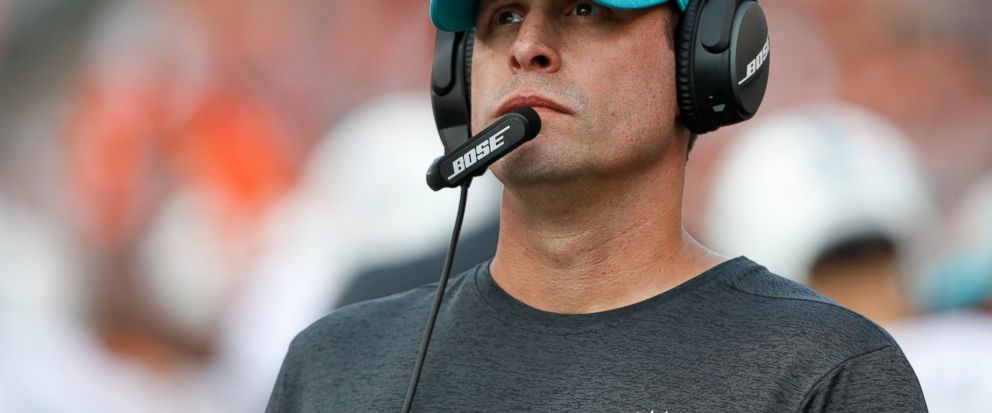 FILE - In this Oct. 7, 2018, file photo Miami Dolphins head coach Adam Gase stand on the sideline during the first half of an NFL football game against the Cincinnati Bengals in Cincinnati. Gase has been fired after three seasons as the Miami Dolphin