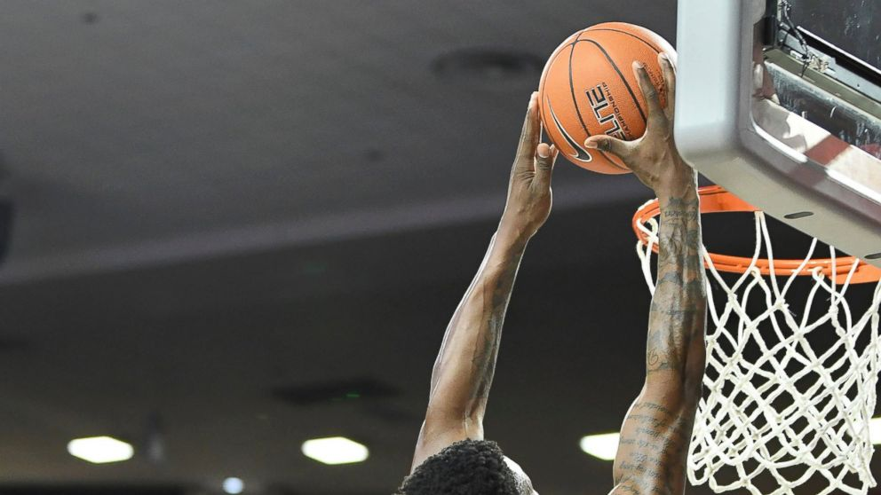 Oklahoma forward Kristian Doolittle dunks the ball against TCU during the second half of an NCAA college basketball game in Norman, Okla., Saturday, Jan. 12, 2019. (AP Photo/June Frantz Hunt)