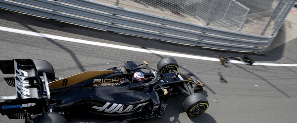 Haas driver Romain Grosjean of France crashes into the guardrails coming out of the pitlane at the start of the first free practice at the Silverstone racetrack, in Silverstone, England, Friday, July 12, 2019. The British Formula One Grand Prix will