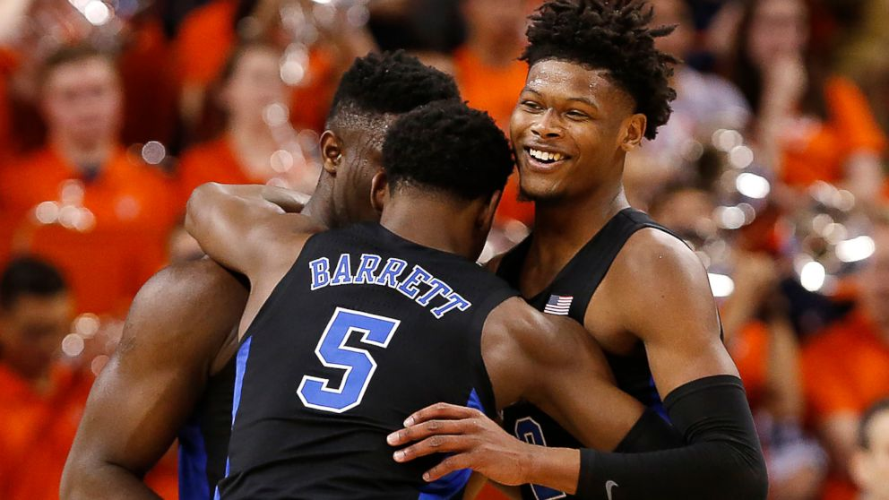 Duke's Zion Williamson, left, RJ Barrett (5) and Cam Reddish celebrate the team's 81-71 victory over Virginia during an NCAA college basketball game in Charlottesville, Va., Saturday, Feb. 9, 2019. (Mark Gormus/Richmond Times-Dispatch via AP)
