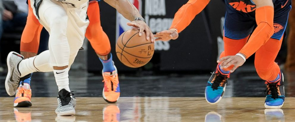 San Antonio Spurs DeMar DeRozan, left, and Oklahoma City Thunders Russell Westbrook chase the ball during the first half of an NBA basketball game, Thursday, Jan. 10, 2019, in San Antonio. (AP Photo/Darren Abate)