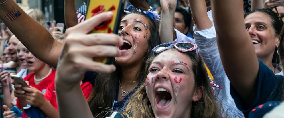 Fans celebrates as members of the the U.S. womens soccer team pass by during a ticker tape parade along the Canyon of Heroes, Wednesday, July 10, 2019, in New York. The U.S. national team beat the Netherlands 2-0 to capture a record fourth Womens W