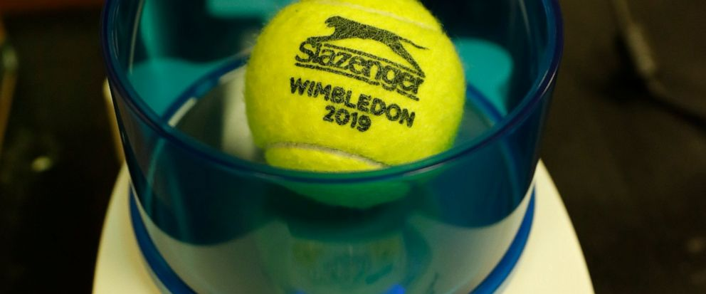 In this photo taken Friday June, 28, 2019, a Wimbledon 2019 tennis ball is weighed at the International Tennis Federation (ITF) lab in Roehampton, near Wimbledon south west London. Based for about 20 years in a three-room area on what used to be a pa