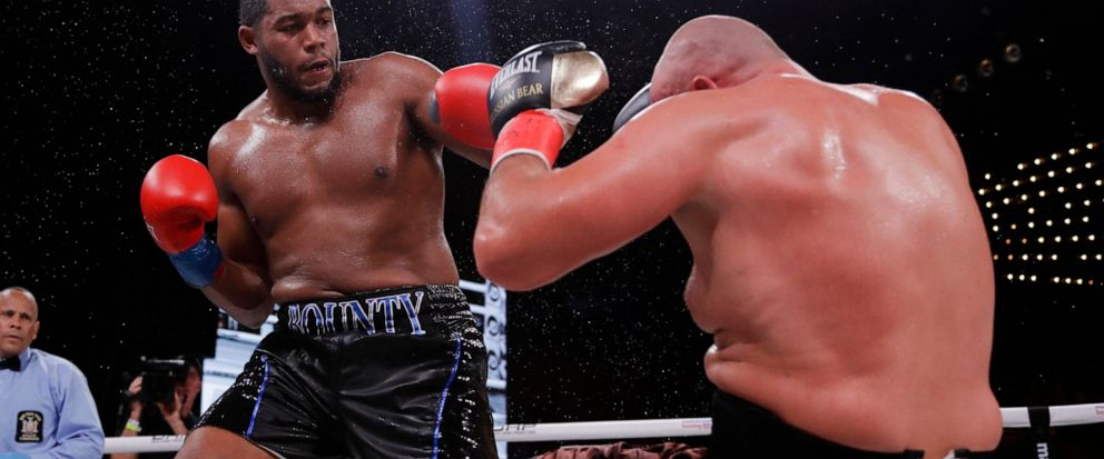 Michael Hunter, left, knocks down Russias Sergey Kuzmin during the fifth round of a heavyweight boxing match Friday, Sept. 13, 2019, in New York. Hunter won the fight. (AP Photo/Frank Franklin II)