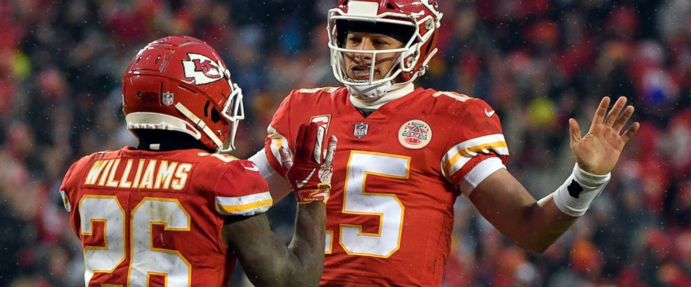 Kansas City Chiefs quarterback Patrick Mahomes (15) celebrates a touchdown with running back Damien Williams (26) during the first half of an NFL divisional football playoff game against the Indianapolis Colts in Kansas City, Mo., Saturday, Jan. 12,