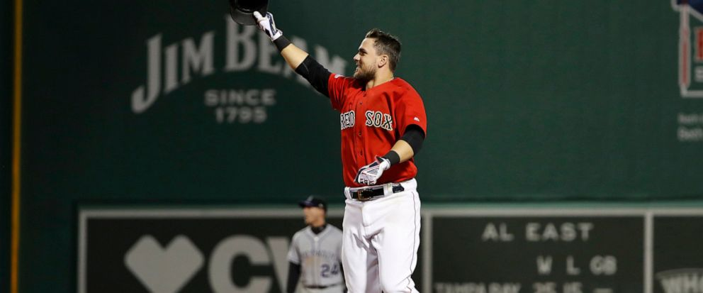 Boston Red Soxs Michael Chavis celebrates his walk-off RBI single against the Colorado Rockies during the 10th inning of a baseball game Wednesday, May 15, 2019, at Fenway Park in Boston. The Red Sox won 6-5. (AP Photo/Winslow Townson)